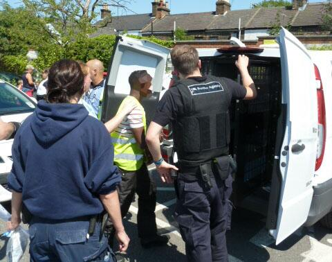 The caption for this picture was, 'A suspected visa overstayer arrested at a Swansea nail bar'.